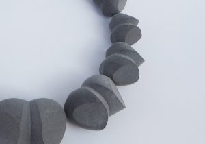 Ursula Guttmann: image of a neckpiece of units, 3D printed in grey nylon.