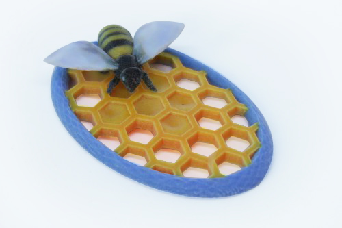 Pin featuring bee on honeycomb