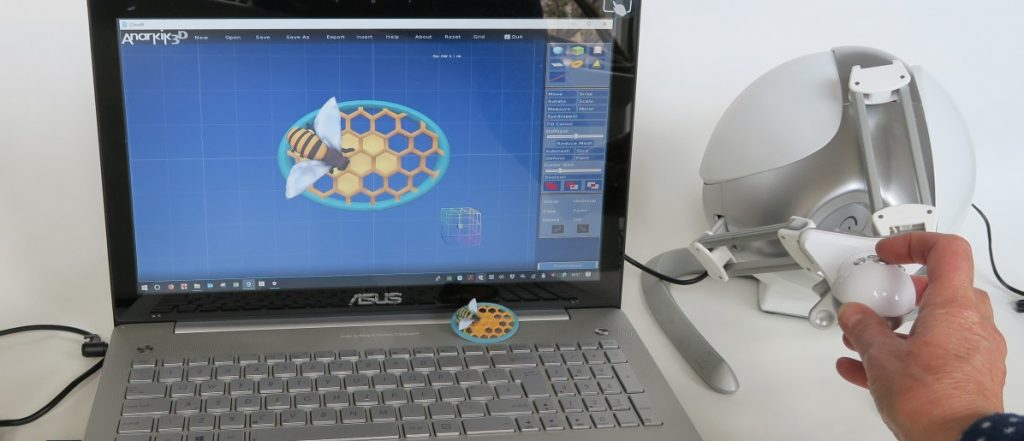 This image shows the Anarkik3DDesign 3D modelling kit: laptop with the haptic 3D modelling software and the falcon haptic device which replaces the 2D mouse or pad,