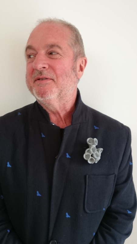 Terry wearing the Bud Brooch by Ann Marie Shillito, 3D printed in soft velvety coloured grey finish