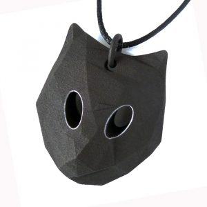 Cat pendant with green eyes and green adjustable cord, designed by Birgit Laken, 3D printed in polyamide, dyed black and with green acrylic paint. Hand finished