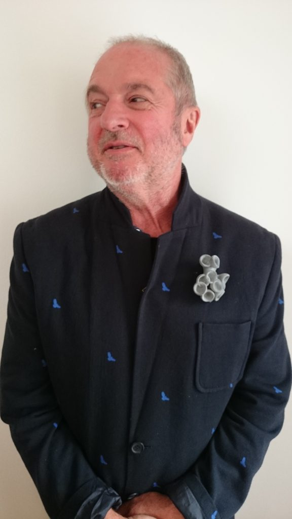 Men wearing jewellery: Terry sporting a large grey pin to complement his lovely jacket.